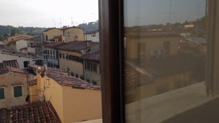 MH DS Bedroom Overlooking Old Town Rooftops / Florence, Italy