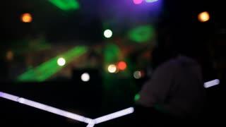 MH Flashing Lights on People Dancing in Nightclub / Singapore