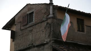 MH LA LD Italian Flag Waving Outside Old Building / Florence, Italy