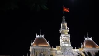 MH LA LD Vietnamese Flag Waving from Top of Ho Chi Minh City Hall at Night / Ho Chi Minh, Vietnam