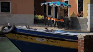 MH LD Boat Moored in front of Cafe / Venice, Italy