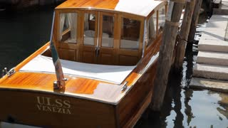 MH LD Rear View of Boat Moored in Water / Venice, Italy
