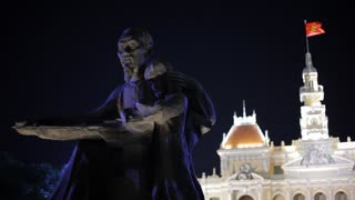 MH LD Statue of Ho Chi Minh at Night with Ho Chi Minh City Hall in Background / Ho Chi Minh, Vietnam