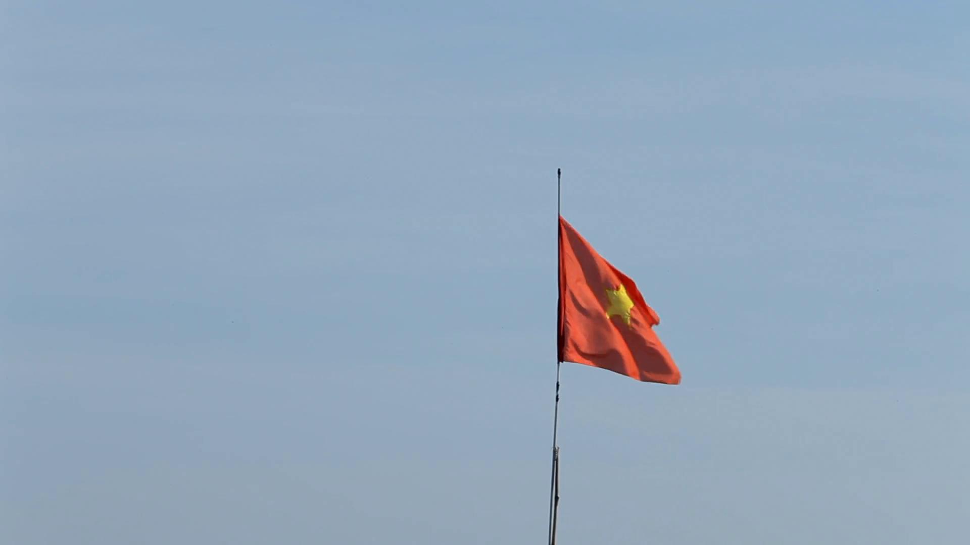 Mh Ld Vietnamese Flag Waving In Wind Vietnam Stock Video Footage Storyblocks