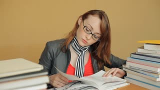 MH LD Young Woman Reading a Book and then Takes off her Glasses