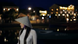 MH LD Young Woman Wearing Ao Dai and Straw Hat at Night / Hoi An, Vietnam