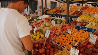MH Man Buying Fruits and Vegetables in Market / Venice, Italy