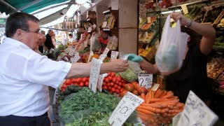 MH Man Buying Vegetables in Market / Venice, Italy