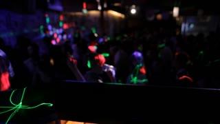 MH PAN Disc Jockey and Lights Flashing on People Dancing in Nightclub / Singapore