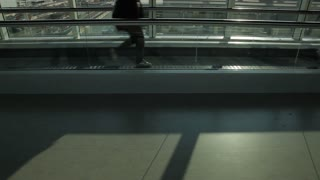 MH People Walking on Moving Walkway