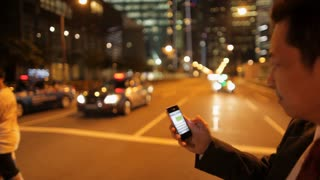 MH TS Businessman Texting While Crossing Street at Night / Singapore