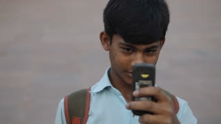MH Young Boy Taking Photos with Phone / India