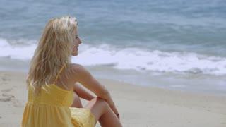 MS Blonde woman sitting on beach