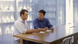 MS Businessmen discussing project in modern office / China