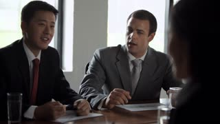 MS Businessmen talking in meeting / China