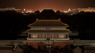 MS Chinese temple rooftop with city skyline in background at night/ Beijing, China