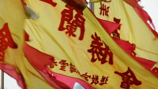 MS Flags with Chinese characters blowing in wind / Hong Kong, China