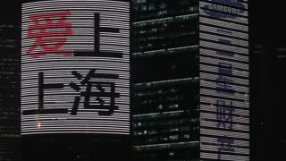 MS Flashing neon signs on city buildings / Shanghai, China