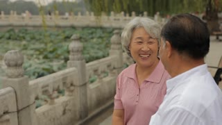 MS HA Elderly couple talking and laughing together in a park/ Beijing, China