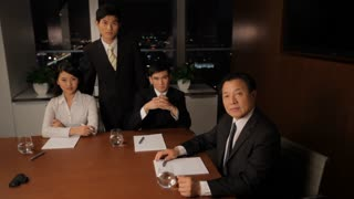 MS HA Portrait of senior businessman with young colleagues in boardroom / China