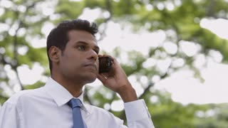 MS LA Businessman using mobile phone standing outdoors
