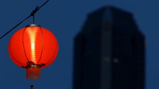MS LA R/F Chinese lantern next to silhouette of building / Singapore