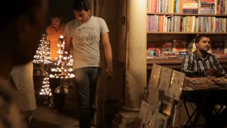 MS Men carrying out oil lamps for Aarti Puja ceremony / Varanasi, India
