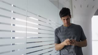 MS Mid-adult man texting in office / India