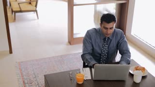 MS Mid-adult man working on laptop at home / India