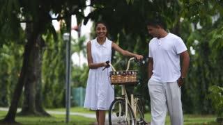 MS PAN Mid adult couple walking through park / Singapore