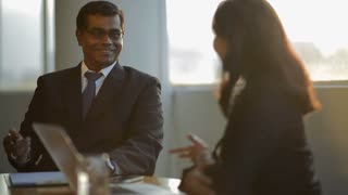 MS PAN SELECTIVE FOCUS Business people talking in board room / Singapore