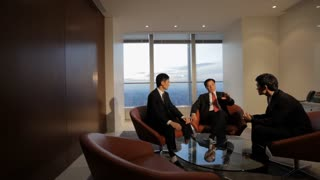 MS PAN Senior businessman talking to young businessmen in office / China