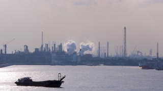 MS PAN View of oil refinery with ship in foreground / Singapore