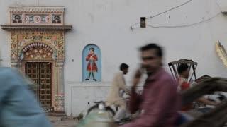 MS People going past ornate doorway / Varanasi, India
