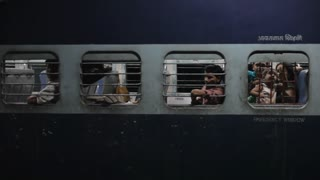 MS People on train at night / India
