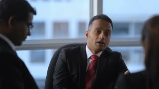 MS SELECTIVE FOCUS Business people talking in board room / Singapore