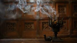 MS Smoke from burning incense in metal holder / Singapore