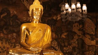 MS TD Golden Buddha statue in temple with worshippers / Wat Pho, Bangkok, Thailand