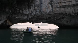MS Tourists in small boat in Ha Long Bay / Vietnam