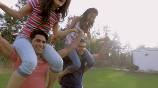 MS TS Men giving piggyback ride to girlfriends / India
