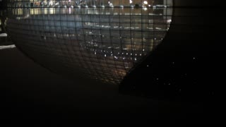 MS TU National Grand Theater reflecting in lake at night / Beijing, China