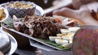 MS TU Woman preparing food on traditional boat