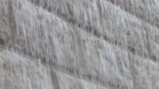 MS Water falling down stone wall / Hong Kong, China