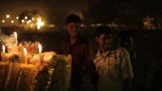 MS Young boys laughing on street at night / New Delhi, India