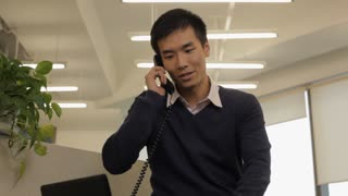MS Young business man talking on phone in office / China