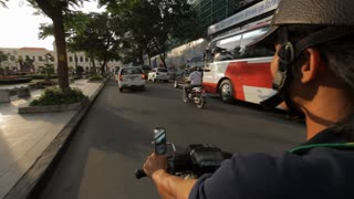 POV WS Motorcycle Driving down Busy Street / Ho Chi Minh, Vietnam