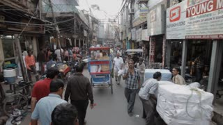 POV WS PAN Busy market street / New Delhi, India
