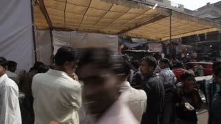 POV WS PAN Busy street scene with traffic / India