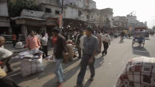 POV WS PAN Busy street scene with traffic / New Delhi, India