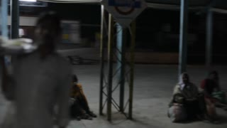 POV WS People at train station at night / India
